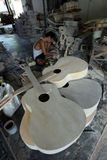 Guitar. Crafters are doing making acoustic guitars in guitar industry center in Sukoharjo, Central Java, Indonesia Royalty Free Stock Images