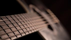 Guitar in the dark stock photography