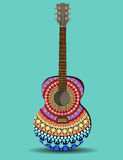 The guitar is decorated with pattern in the style of a mandala Royalty Free Stock Images
