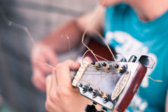 Guitar detail. Image showing a guy playing his acoustic guitar Royalty Free Stock Photo