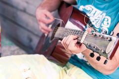 Guitar detail. Image showing a guy playing his acoustic guitar stock photo