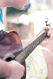 Guitar detail. Image showing a guy playing his acoustic guitar royalty free stock image