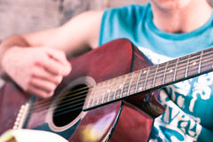Guitar detail. Image showing a guy playing his acoustic guitar Royalty Free Stock Photography