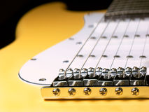 Guitar detail. Detailed view of a yellow electric guitar Stock Photo