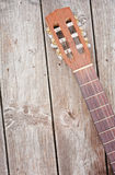 Guitar Detail. Nylon string acoustic guitar neck and headstock on weathered boards Stock Photography