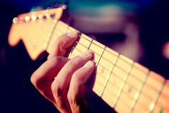 Guitar detail. Playing instrument.Hand and chord Royalty Free Stock Image