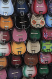 Guitar Display. Display of several rows of colorful guitars Royalty Free Stock Images