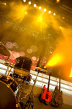 Guitar and drums. Bass guitar and drums on the stage royalty free stock image