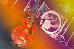 Guitar and drums on stage Stock Photos
