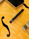 Guitar. Electric guitar closeup with strings and bridge Stock Image