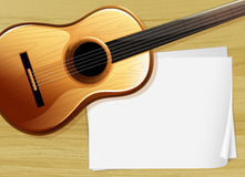 A guitar with an empty bondpaper Stock Photo
