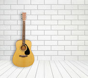 Guitar in empty room background Stock Image