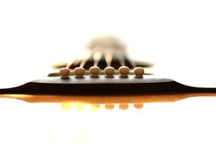 Guitar End Pins. The bottom end of a guitar where the strings terminate royalty free stock images