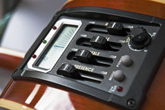 Guitar equalizer and tuner. Close up studio shot of acoustic guitar equalizer and tuner Stock Photo