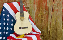 Guitar and fall leaves on flag Royalty Free Stock Photo