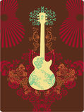 Guitar Fantasy. A guitar decorated with flower and ornaments Royalty Free Stock Photography