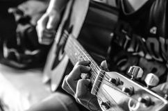 Guitar. Female hand on classical guitar , black and white color Stock Photography