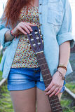 Guitar in female hands. Stock Photography