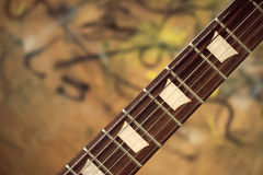 Guitar fingerboard. Against corfull background Stock Photos