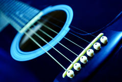 Guitar fingerboard. Guitar side view, strings and fingerboard with a shallow depth of field Royalty Free Stock Image
