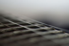 Guitar fingerboard close up. On dark background stock photography