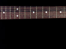 Guitar fingerboard  isolated on black background. Guitar fingerboard close up isolated on black background Royalty Free Stock Photos