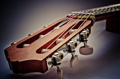 Guitar fingerboard. Macro on a blue background Royalty Free Stock Photos