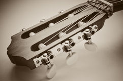 Guitar fingerboard. Macro on a blue background Royalty Free Stock Images