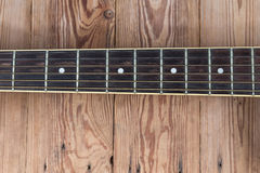 Guitar fingerboard. On wooden background Stock Photography