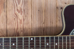 Guitar fingerboard. On wooden background Stock Images