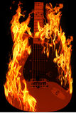 Guitar on fire. Fire and guitar example of hard rock music Royalty Free Stock Image
