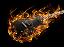 Guitar in fire. Electric guitar in fire and flames on black background royalty free stock images