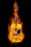 Guitar in fire Stock Images