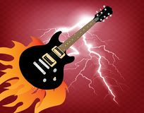Guitar in a flame. Guitar in flame - the symbol of rock music in the middle of a concert Royalty Free Stock Image