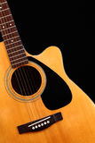 Guitar. Folk guitar on black background Royalty Free Stock Images