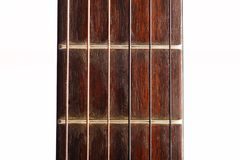 Guitar fret board. Color detail with the fret board of a guitar Royalty Free Stock Photography