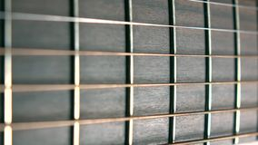 Guitar fret and six strings, shallow focus. Music performance. Macro shot. Guitar fret and strings. Music performance Royalty Free Stock Photos