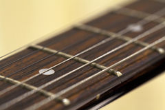 Close up guitar fretboard. Guitar fretboard in close up with a shallow depth of field across the fret and strings stock photography