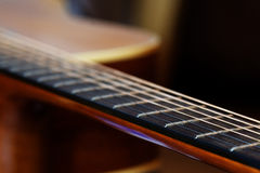 Guitar fretboard, detail with shallow depth of field Royalty Free Stock Photo