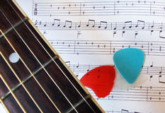 Guitar fretboard, picks and music sheet Royalty Free Stock Images