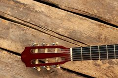 Guitar fretboard with strings. Part of classical guitar on old wooden boards stock photos