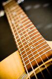Guitar Frets. The neck of the guitar leads the strings down a road Royalty Free Stock Images