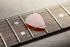Guitar frets with mediator on strings Stock Image