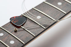 Guitar frets with string and mediator. On white Stock Photos