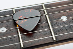 Guitar frets with strings and mediator Stock Images