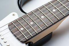 Guitar frets with strings Royalty Free Stock Images