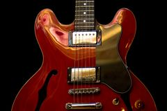 Guitar front. Body of red electric guitar Royalty Free Stock Images