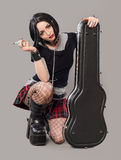 Guitar girl. Gothic young woman with her hot guitar stock photography