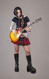 Guitar girl. Gothic young woman with her hot guitar Stock Image