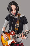 Guitar girl. Gothic young woman with her hot guitar Royalty Free Stock Photos